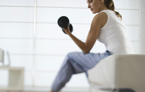 Telecommuting Woman Lifting Weights   Work-at-Home Fitness   DIETSiTRIED