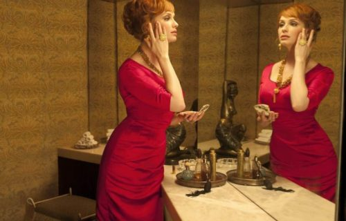 Woman in Red Dress Staring in the Mirror Rocking Body Positivity | DIETSiTRIED